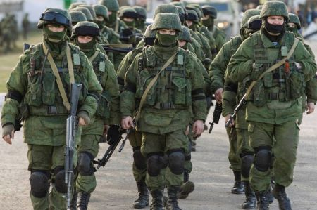 Military-personnel-believed-to-be-Russian-servicemen-walk-outside-the-territory-of-a-Ukrainian-military-unit-in-the